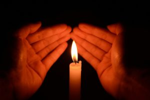 http://www.dreamstime.com/stock-photos-hands-holding-burning-candle-dark-closeup-black-background-image36151153